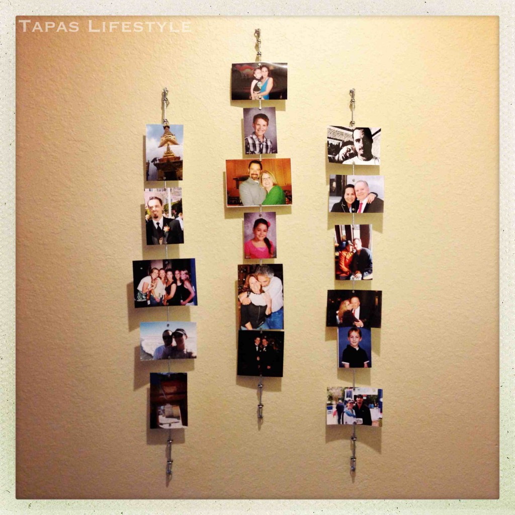 Wall of Family Photos attached to wires by magnets